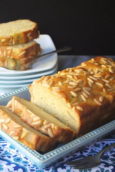 A delicious loaf cake bursting with juicy bits of apple and topped with crunchy pine nuts.