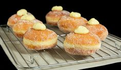 Bomboloni, Italian Donuts rolled in sugar and filled with Crema Pasticcera.