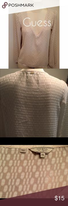 V-neck blouse GUESS Long sleeve peasant blouse. Deep V neckline. Puff sleeve. Elastic cuff. Size XS. Cream colored. Perfect for layering! Offers will be considered through the 'OFFER' button. Guess Tops Blouses