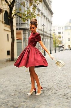 Shop this look on Lookastic:  http://lookastic.com/women/looks/burgundy-skater-dress-white-leather-handbag-white-and-red-leather-pumps/10840  — Burgundy Skater Dress  — White Leather Handbag  — White and Red Leather Pumps