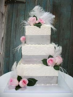 Wedding Cakes: Pink flowers and lace on wedding cake