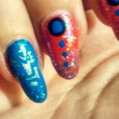 Autobots accent nail on the optimus prime inspired mani.