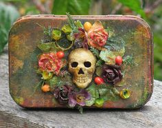 Love this altered tin with floral and skull motive.