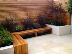 Like the idea of extending the indoors outside... nice fence, too!