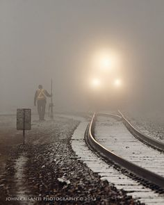 train running through the winter fog