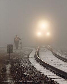 train running through the winter fog