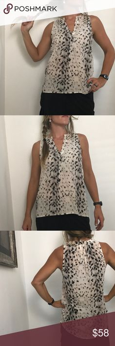 "Joie Silk sleeveless snow leopard print top In excellent condition. Worn and then dry cleaned.   100-% silk Great slinky top!  Measurements:  shoulders: 11"" Chest: 19"" Length: 21"" / 30"" C1 snow leopard print silk top joie Joie Tops Blouses"