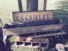 Old wood chicken feeder & creamery sign Talmadge Road Merchantile