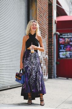 100+ Outfits We're Copying From The Streets Of New York City #refinery29  http://www.refinery29.com/2016/09/120553/nyfw-spring-2017-best-street-style-outfits#slide-33  Cooling down with some iced coffee and a skirt that catches the breeze....