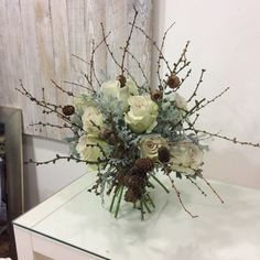 Wintery white roses complimented by the icy silver oak leaf and natural twig make this bridal bouquet perfect for a cool Irish Winter wedding. Wedding Flowers, Wedding Day, White Roses, Compliments, Christmas Wreaths, Floral Wreath, Reception, Bridal Bouquets, Holiday Decor