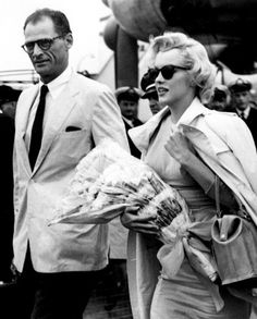 "Marilyn Monroe arrives with husband Arthur Miller in London to film ""The Prince and The Showgirl"", 1956"