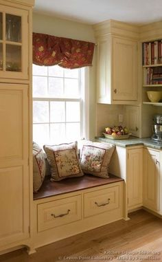#Kitchen Idea of the Day: Antique White Kitchen with beautiful window seat. (By Crown Point Cabinetry)