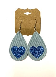 Excited to share this item from my #etsy shop: Light blue jean denim teardrop earrings blue glitter heart dangle boho hippie women statement jewelry love friendship handmade gift unique#light#blue#jean#denim#fabric#teardrop#earrings#heart#glitter#love#friendship#boho#hippie#women#statement#jewelry#handmade#homemade Unique Earrings, Earrings Handmade, Handmade Jewelry, Handmade Gifts, Glitter Hearts, Blue Glitter, Denim Earrings, Light Blue Jeans, Stainless Steel Earrings