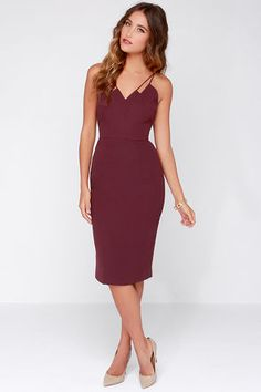 My, my, my! We have never laid eyes on a dress quite as lovely as the Keepsake Skinny Love Burgundy Midi Dress! Skinny double spaghetti straps top this poly-blend dress, which boasts a layered neckline with a chic zigzag effect, enhanced by darted seams and a fitted waist. A midi length skirt creates a sleek finish ending with a kick pleat at back