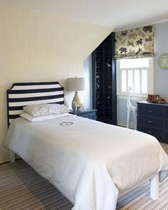 INSPIRATION FOR NEW HEADBOARD Suzie: Finnian's Moon Interiors - Adorable big boy's bedroom with ivory wood paneling, white & ...