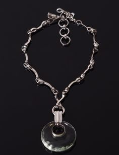 https://www.cityblis.com/6462/item/8749  ON14 Round - $625 by Mademoizelle Sefra jewelry  Mademoizelle Sefra's Jewelry Necklace in 925 sterling silver and crystal  Dimensions :  - Stone : 4,5 cm diameter x 6 cm high (including the attach) - Chain at it's longer : 43 cm - Chain at it's smaller : 38 cm