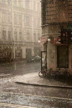I'd love to be on a street like this in Paris...getting soaked...running into a coffee shop to relax and dry off!
