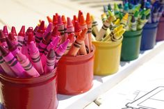 Crayon Storage.  Paint or cover soup cans / jars and organize crayons by color.