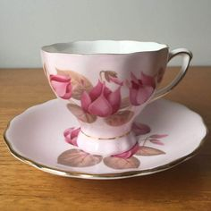 Colclough Teacup and Saucer, Light Pink Tea Cup and Saucer with Dark... (€26) ❤ liked on Polyvore featuring home, kitchen & dining, drinkware, pink teacup, vintage tea cups and saucers, vintage teacups, vintage saucer and bone china