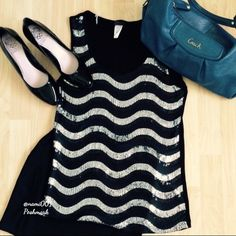 """Sequins Zig Zag Black Silver Pattern Tank Top NWOT This trendy sequins zig zag pattern tank top can go from work chic to fashion forward night out. Pair with a pencil skirt & blazer for work or for a night out, sexy black mini skirt and a colored purse for a pop of color.  Measures 16"""" underarm to underarm & 26"""" in length. COACH PURSE SOLD SEPARATE. Bundle and save 10% on 2 items or more. 🚫NO TRADES Agenda Tops Tank Tops"""