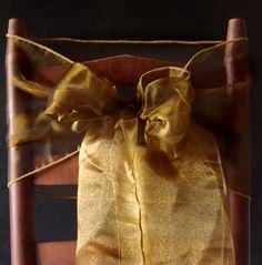 Gold organza chair ribbons