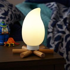 "It might not be great for roasting marshmallows, but this Campsite Nightlight is much more convenient than building an actual fire in the house. Details, details Nod exclusive Nightlight resembles a small campfire complete with small logs and a plastic ""flame"" Perfect addition to any room Type B 5W CFL light bulb included;also accommodates a 7W max."