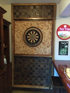 This dart board back board is located at The Boardroom Pub & Grill in Pismo Beach, California. Made from 100% salvaged, re-purposed and reclaimed materials.