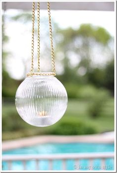 """Great Tutorial on how to make an outdoor hanging light 3 1/4"""" – Prismatic Glass light globe Hardware store chain, cut into 4 sections: Enough to go around lip of globe and three equal lengths to hang. Any narrow chain will work. The one used is called #300 Hobby Twist Chain 5 jump rings. Use a small one to connect the chain around the globe and larger ones to hang. Wire Cutters"""