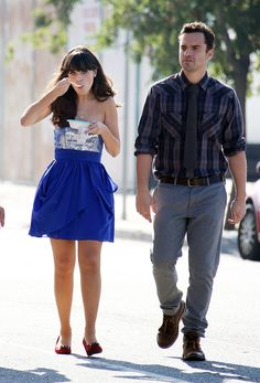 An adorable Zooey Deschanel, in a strapless blue dress, grabs a bite to eat with Jake Johnson on the set of her hit Fox TV show New Girl in Los Angeles.