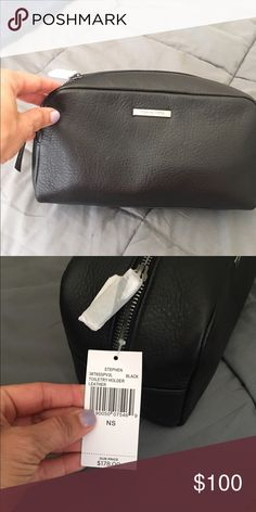 Men's Micheal Kors travel toiletry bag Brand new, with tags Men's Micheal Kors toiletry bag. Black leather, never used bag. Authentic Michael Kors, no gimmicks Michael Kors Bags Travel Bags