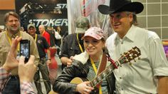 Stars Come Out at ATA! Outdoor Channel pro Jim Shockey poses with an admiring fan at the Archery Trade Association show in Nashville.