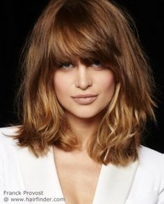 Shoulder length hairstyle with long bangs and ombré colors.