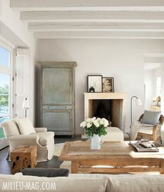 Modern farmhouse living room with French Country decor by Eleanor Cummings. #livingroom #frenchcountry #frenchfarmhouse #europeancountry