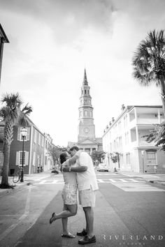 Downtown Charleston engagement shoot with historic churches and buildings in the background