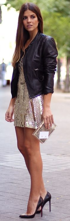 Awesome legs in a sparkly mini dress, high heels and leather jacket.