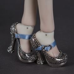 I want sterling silver shoes, too! Enchanted doll.