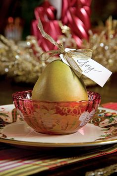 Coordinate with the fruit featured in the china pattern, and set a juicy pear, tied with a shiny bow and a place card, at each guest's plate.