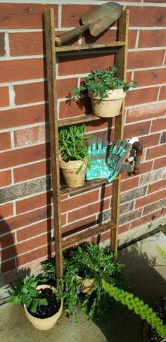I bought this latter @ an antique store for $10 dollars. The rustic garden tool for $3, the weathered pots for 89cents each...added some herbs/ flowers & an old pair of garden gloves that my daughter wore as a little girl...I love this collection of things.