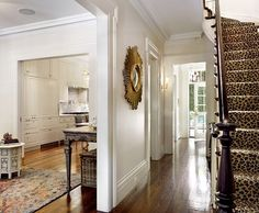 White walls, gorgeous wood floor, leopard stairs in Brooklyn...