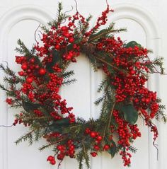 This wreath is for purchase, but it can serve as DIY inspiration. Take an inexpensive grapevine wreath (whatever size suits your needs) and add cedar or other evergreen stems, holly or magnolia or other green leaves, assorted sized red berries, and pine cones. Simple, traditional, beautiful.