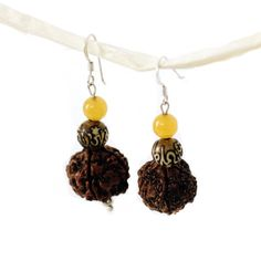 Rudraksha & Pearl Earrings - Global Groove - Fair Trade - #thisbluesea #fairtrade #shopfairtrade  These 1.5-inch long earrings feature silver hooks and the Rudraksha seed which derives from Rudra (a name for Lord Shiva) and Aksha (tear) ‰ÛÒ ‰ÛÏthe fruit born of the tear of Lord Shiva.‰  Meet the Artisans  Global Groove Global Groove is a fair trade organization working with women by supporting and developing artisan co-ops in Thailand and Nepal. The Fair Trade industry is expanding and we…