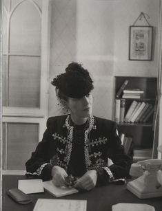 Daisy Fellowes wearing Molyneux at her office in London in 1941. Photo by Cecil Beaton. Vogue July 15, 1941.