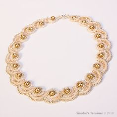 originally published in the December 2011 issue of Bead&Button magazine (Ravishing Rosettes) Swarovski crystal beads, Japanese seed beads and round glass pearl beads. make the rosettes lay flat : add 15's to the inner row of the scallop or 8's in the outer row of the scallop