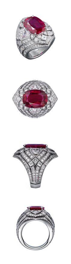 Cartier FLEUR DE LOTUS RING Platinum, one cushion-cut ruby (8.38 carats) from Burma, calibré-cut diamonds, brilliant-cut diamonds.