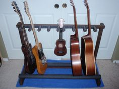 Multiple Guitar Stand made out of wood. Looking for possible stand ideas for my room. All my guitars are falling all over the place. And I hate the fact that they have to be kept in they're cases. It's also extremely hard to open all of them in my room. This might be able to do for me. Looking for something with limited space though. If it doesn't work I could always sell it.