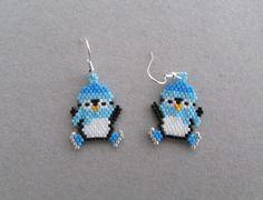 Beaded Ice Skating Penguin Earrings by DsBeadedCrochetedEtc on Etsy https://www.etsy.com/listing/250488503/beaded-ice-skating-penguin-earrings