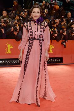 """To the premiere of """"Django"""" at the opening of the 67th Berlinale Film Festival, Maggie Gyllenhaal wore a Gucci Cruise 2017 silk chiffon gown with lace detail and silk floral brooch by Alessandro Michele."""