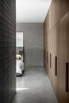 Masonry walls enclose courtyards and living spaces at Melbourne house