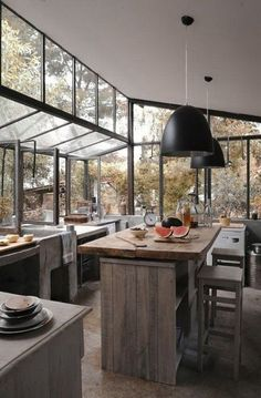 Not my usual taste in kitchen but this is a beautiful idea for a house backing up on a mountain or in a forest.