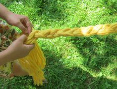 Divide the strands of yarn into three sections and braid to the end. Secure the end by tying with a bit of yarn. Unknot the other end and secure with yarn. Trim ends.